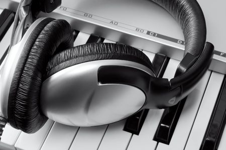 Headphones on synthesizer keyboard photo