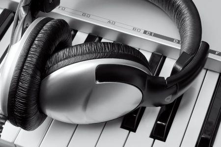 Headphones on synthesizer keyboard Stock Photo - 4728354