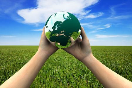 earth pollution: Earth in hands Stock Photo