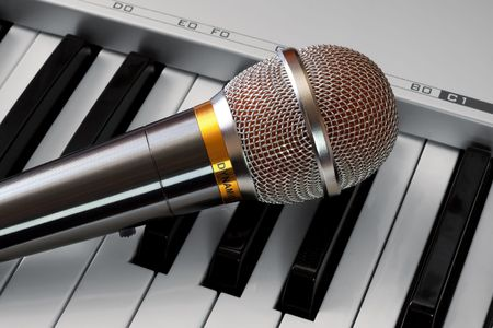 Microphone on synthesizer keyboard photo