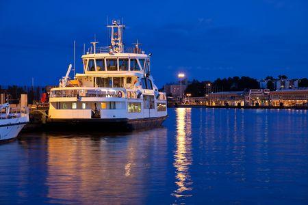 docked: Small docked tourist ship Stock Photo
