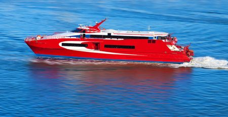 Red yacht with motion blur photo
