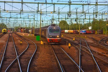 Freight train passing railway station photo