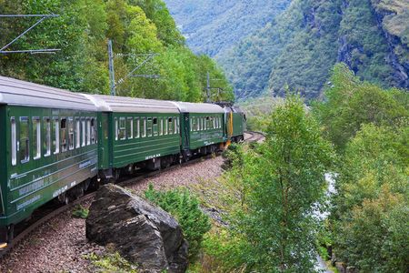 famous industries: By the train across Scandinavian mountains Stock Photo