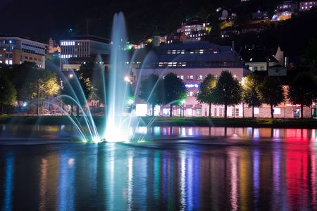 Night pond with fountain in Bergen, Norway photo