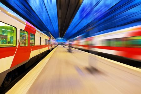 Passenger train passing railway station Stock Photo - 7298731