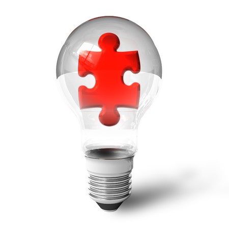 Puzzle piece in lightbulb photo