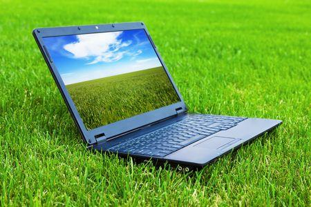 Laptop on grass photo