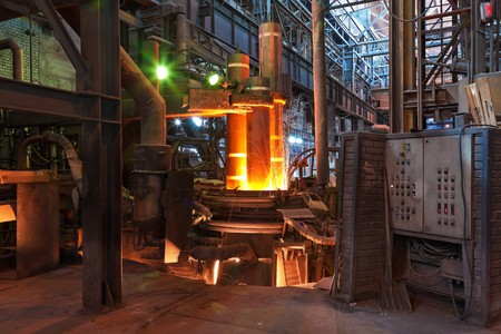 Electroarc furnace at metallurgical plant photo