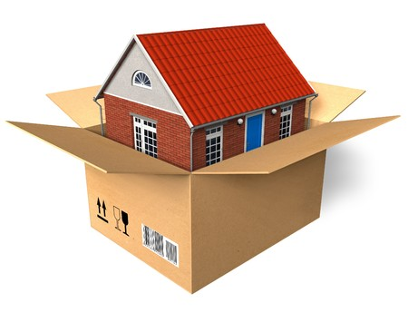 cardboard house: New house in box Stock Photo