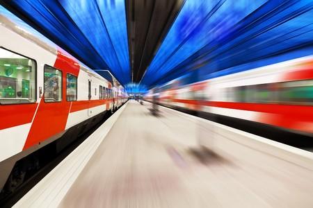Passenger train passing railway station Stock Photo - 7947013