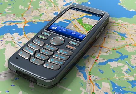 gps navigation: Tel�fono m�vil con sistema de navegaci�n GPS en el mapa  Foto de archivo