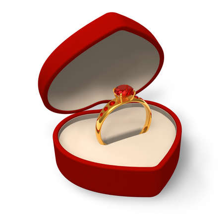 Heart-shape box with golden ring with jewels photo