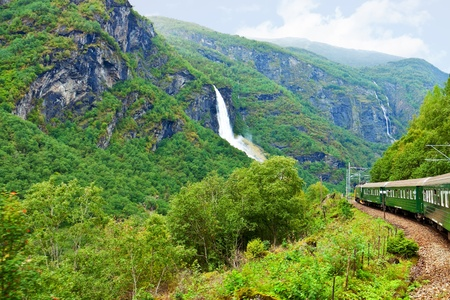 forest railway: By the train across Scandinavian mountains Stock Photo
