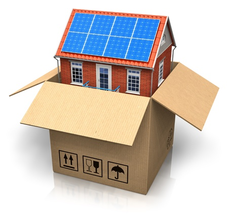House with solar batteries in cardboard box photo