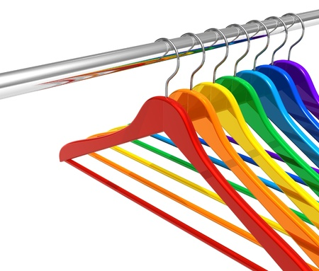 Rainbow hangers on clothes rail photo