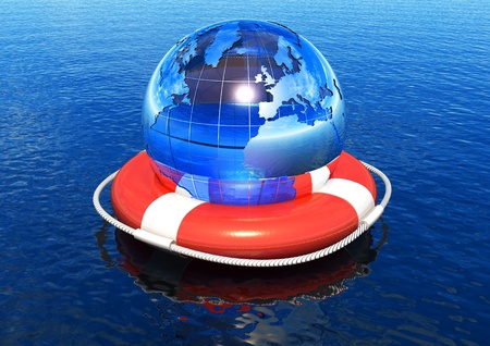 Earth globe in lifebuoy floating in water photo