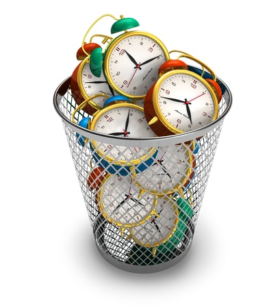 money and time: Wasting time concept: alarm clocks in the trash bin
