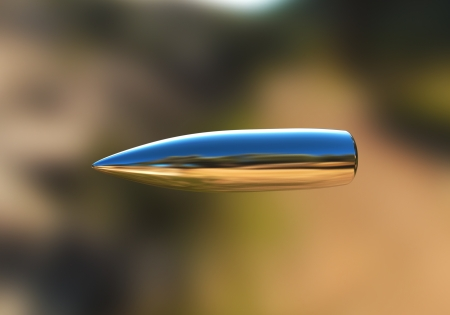 Macro shot of silver bullet caught in flight Stock Photo - 9597017