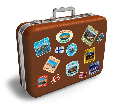 maleta: Maleta de viaje de cuero marr�n con coloridas etiquetas aisladas sobre fondo blanco  Foto de archivo