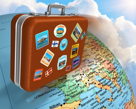 tourist destination: Leather travel suitcase with labels flying around the Earth globe