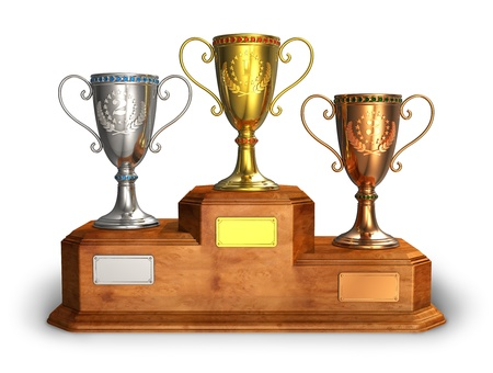 Gold, silver and bronze trophy cups on wooden pedestal isolated on white background photo