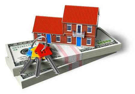 Red brick cottage on stacks of dollars and house keys isolated on white background photo