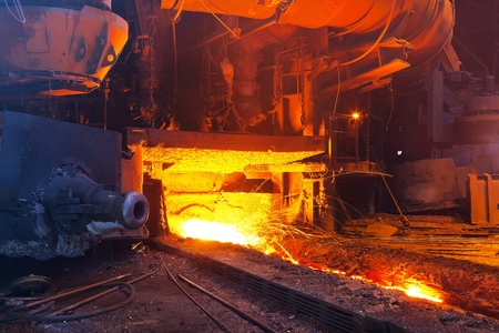 Close view of working blast furnace at the metallurgical plant photo