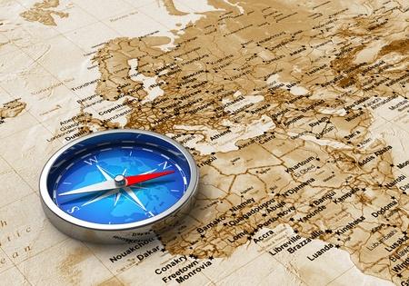 gps navigation: Vista macro de br�jula metal azul en el mapa del mundo antiguo