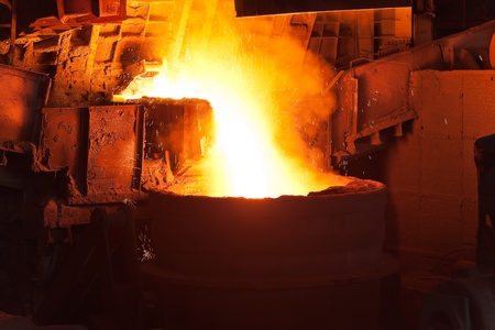 iron works: Pouring of liquid metal in open hearth workshop of the metallurgical plant Stock Photo
