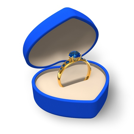 Blue heart-shape box with golden ring with jewels photo
