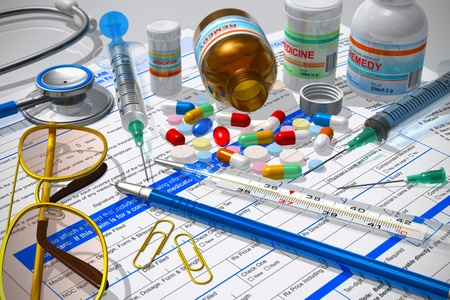 Medicalpharmacy concept: macro view of pills, stethoscope, syringes, thermometer and other medical supplies on prescription documents photo