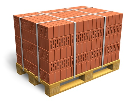 Stacked bricks on wooden shipping pallet isolated on white background photo