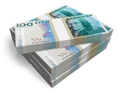 Stacks of Swedish krones isolated on white background photo