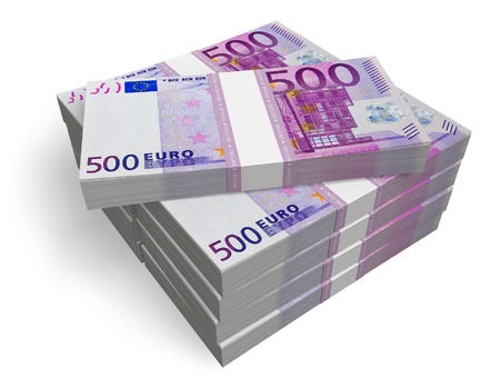 money exchange: Stacks of 500 Euro banknotes isolated on white background Stock Photo