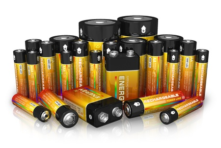 9v battery: Group of different size batteries isolated on white reflective background  Stock Photo