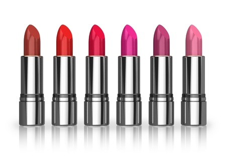 Set of red lipsticks isolated on white reflective background photo