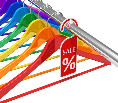 Sale and discount concept: row of colorful rainbow hangers with promotion label photo