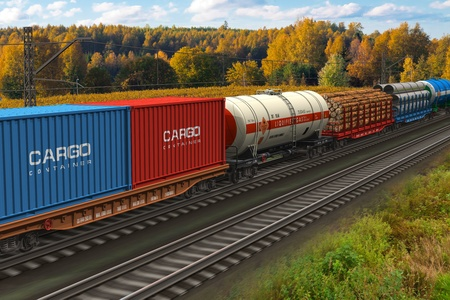 Scenic view of mixed freight train within rural landscape     Stock Photo