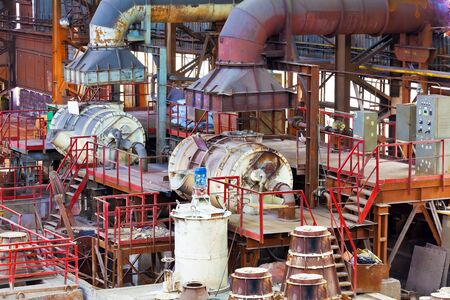 Heavy foundry equipment in casting hangar of metallurgical plant photo