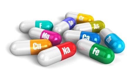 vitamina a: Grupo de color de las p�ldoras de vitaminas aisladas sobre fondo blanco