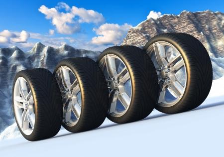 Automotive concept: set van auto wielen in besneeuwde bergen Stockfoto