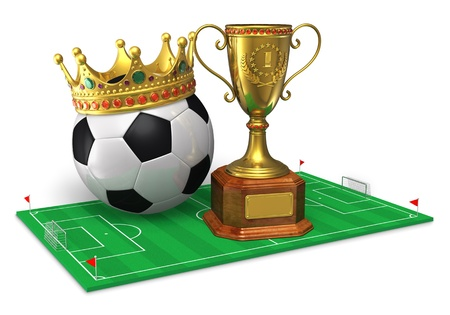 Football championship concept  golden trophy cup and soccer ball with crown on green soccer field isolated on white background photo