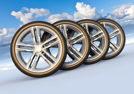 Automotive concept  set of car wheels in scenic snowy landscape photo