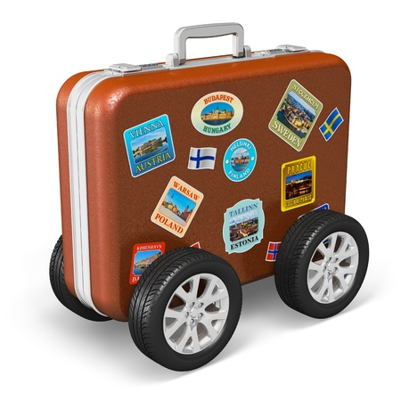 Travel around the world and tourism concept  leather travel case with label tags and car wheels isolated on white background   All photos used here  are my own from my own portfolio photo