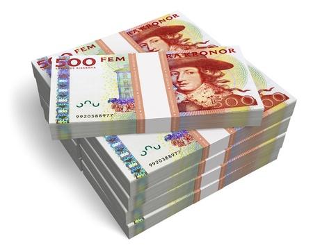 Stacks of 500 Swedish krona banknotes isolated on white background photo