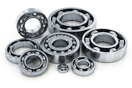 spare parts: Collection of different steel shiny ball bearings isolated on white background with reflection effect Stock Photo