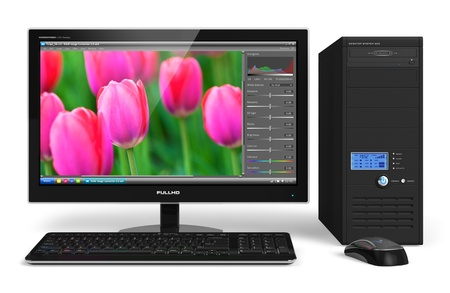 Desktop computer with photo editing software on screen photo