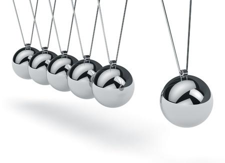 physics background: Metal Newton s cradle isolated on white background