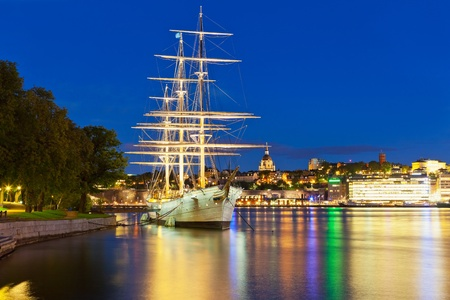 Wonderful summer night scenery of the Old Town with historcal ship at Skeppsholmen island in Stockholm, Sweden photo